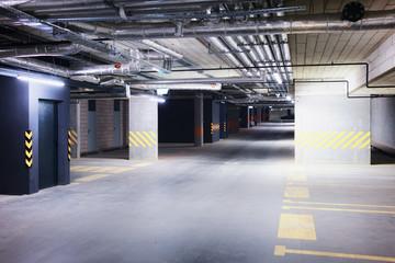 Underground car parking garage in European modern apartment building