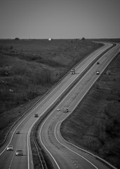 Two empty parallel lanes of a highway without cars top view. Black and white