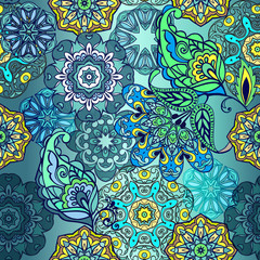 Seamless pattern with mandala and fantastic flowers with paisley. Floral wallpaper. Decorative ornament for fabric, textile, wrapping paper.