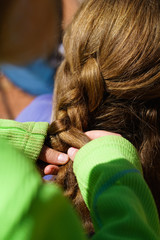 Hands Braiding Hair