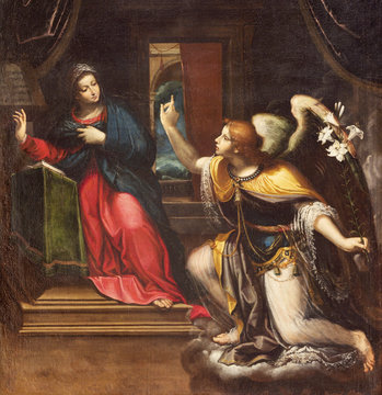 REGGIO EMILIA, ITALY - APRIL 13, 2018: The detail of painting of Annunciation in chruch Chiesa di Santi Giacomo e Filippo apostoli by unknown artist.