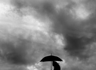 female silhouette with umbrella
