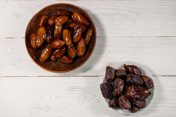 Dried dates fruit on white wooden table. Top view