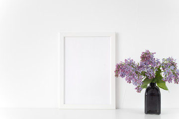 White frame with lilac bouquet on white background