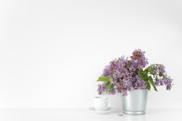Composition with lilac bouquet on white background
