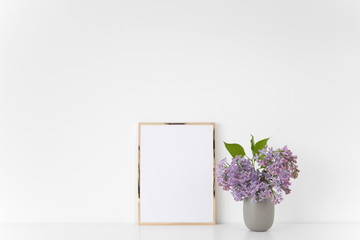 Gold frame with lilac bouquet on white background