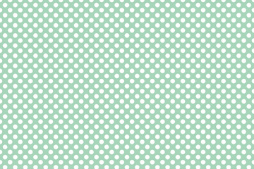 White and green polka dot background pattern
