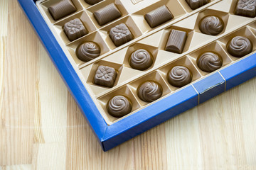 Square box with different chocolate sweets set