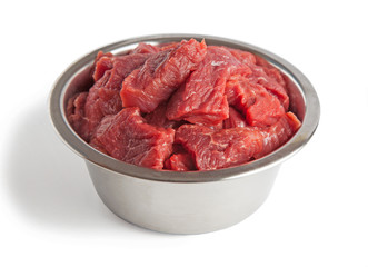 Raw beef meal in bowl, fresh, natural food for dog or cat, isolated on white background.  Wall mural