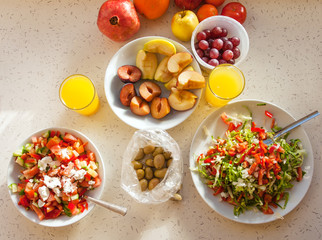 Healthy breakfast with salad, fruits and orange juice