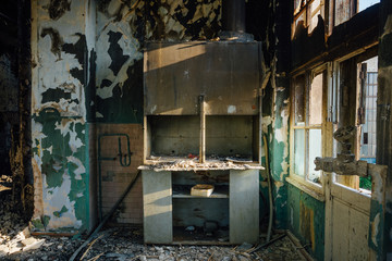 Burned clinic interiors after fire. Burnt furniture