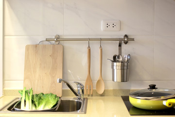 kitchen cabinet with sink and electric stove