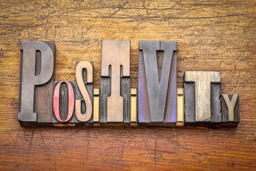positivity - word abstract in wood type