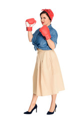 full length view of beautiful size plus pin up model in boxing gloves looking at camera isolated on white