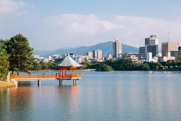 Lake and gazebo at Ohori park in Fukuoka, Japan Wall mural