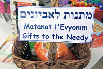 Gifts to the needy basket on Purim Jewish holiday