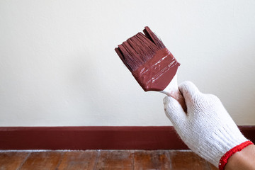 Professional Painter Holding His Paintbrush After Paint Beautiful Decoration Wall.