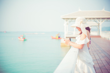 Women travel alone at the sea and beach on Summer. Chonburi Thailand.