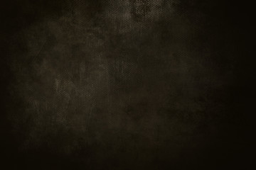 old dark brown grungy canvas background or texture