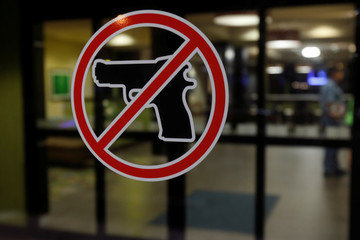 A no gun sign is seen posted outside a hotel in Sikeston, Missouri