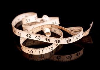 measuring tape helps to track your weight loss and muscle gains