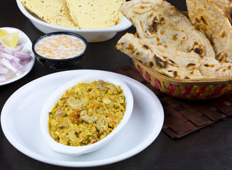 Indian Traditional Vegetarian Cuisine Kaju Curry Also Called Kaju Butter Masala Served with Tandoori Roti, Raita, Salad And Papad