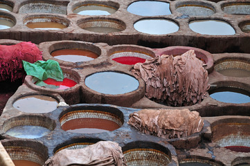 wells filled with dyes in tannery in Fez, Morocco