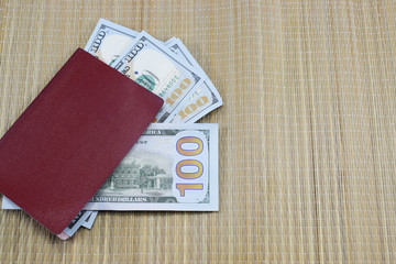 Passport with money (dollars) for vacation lies on the table