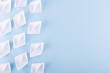 Paper Boats or Paper Ships