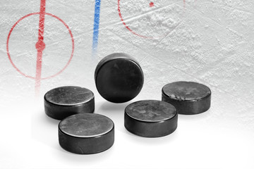 Ice arena with markings and hockey pucks