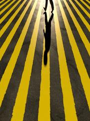 a man crosses the road
