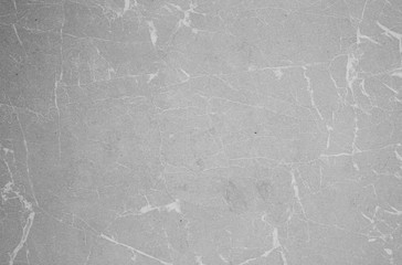 Light beige scratched background texture with white marble veins stria.