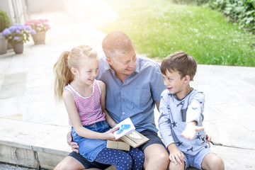 Father´s day - Happy children give gifts  to their smiling father