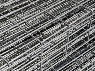 Frame from the reinforcement. Aluminum fittings and armature. Metal rolling plant background