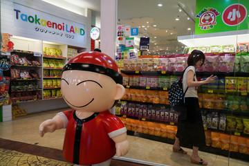 A tourist shops inside a Taokaenoi Land shop at a department store in Bangkok