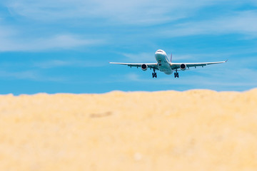 Commercial airplane flying takeoff from international airport with clear sky.