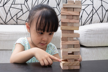 Asian Chinese little girl playing wooden stacks