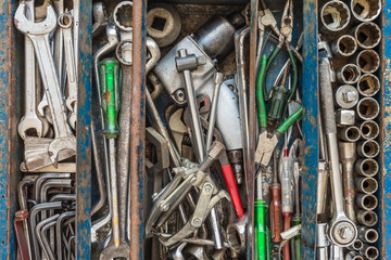 Many tools in rustic compartments toolbox. Technical machanic toolset for car automobile, motorcycle repair or DIY.