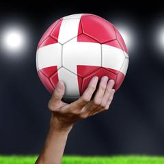 Man holding Soccer ball with Danish flag