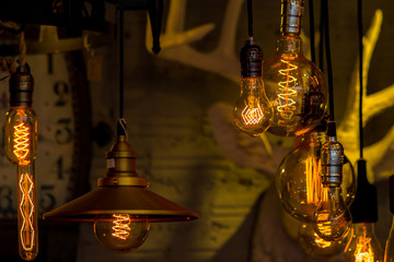 Antique light bulbs and brick wall in the background.