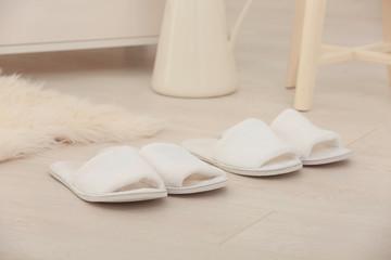 Bathing slippers on floor