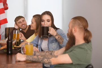 Friends with beer in sport bar
