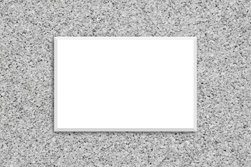 Blank white canvas poster on decorative cork textured wall