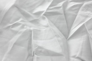 Texture of fabric is white color background,Wavy folds of cloth