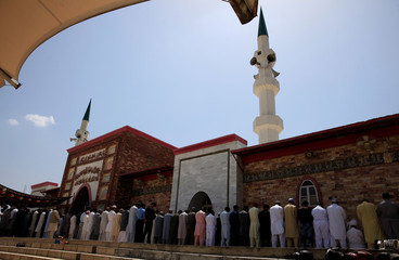 Muslims attend first Friday prayers during the holy month of Ramadan at the Red Mosque in Islamabad