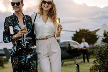 Glamorous women walking with wine