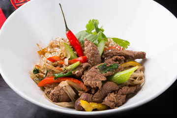 Thai spicy noodles dish with meat