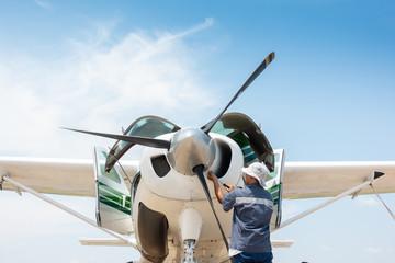 Aircraft mechanic repairs engine of airplane