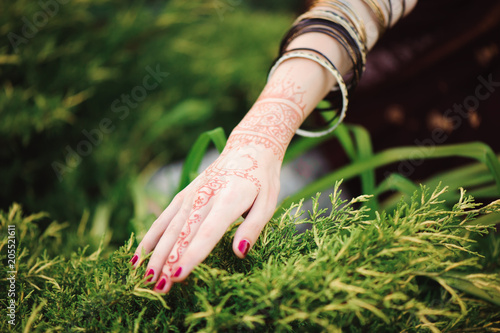 0a9a08ce9 Woman Hands with black mehndi tattoo. Hands of Indian bride girl with black  henna tattoos. Fashion. India