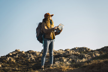 Italy, Sardinia, woman holding map on a hiking trip